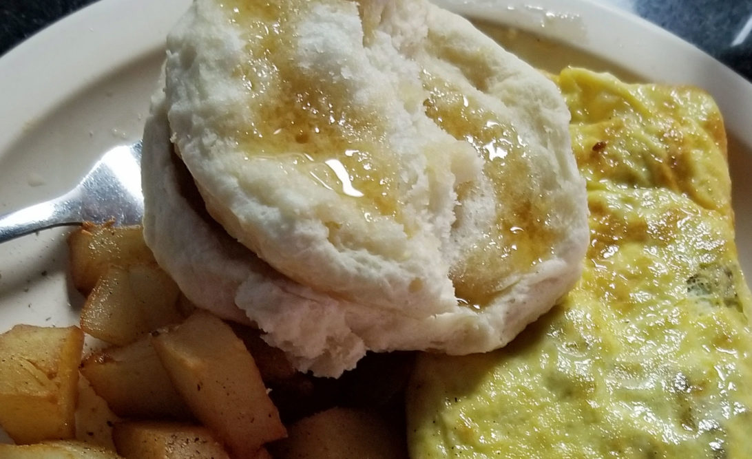 Local honey on egg and biscuits at Ocie's in Mayberry, NC