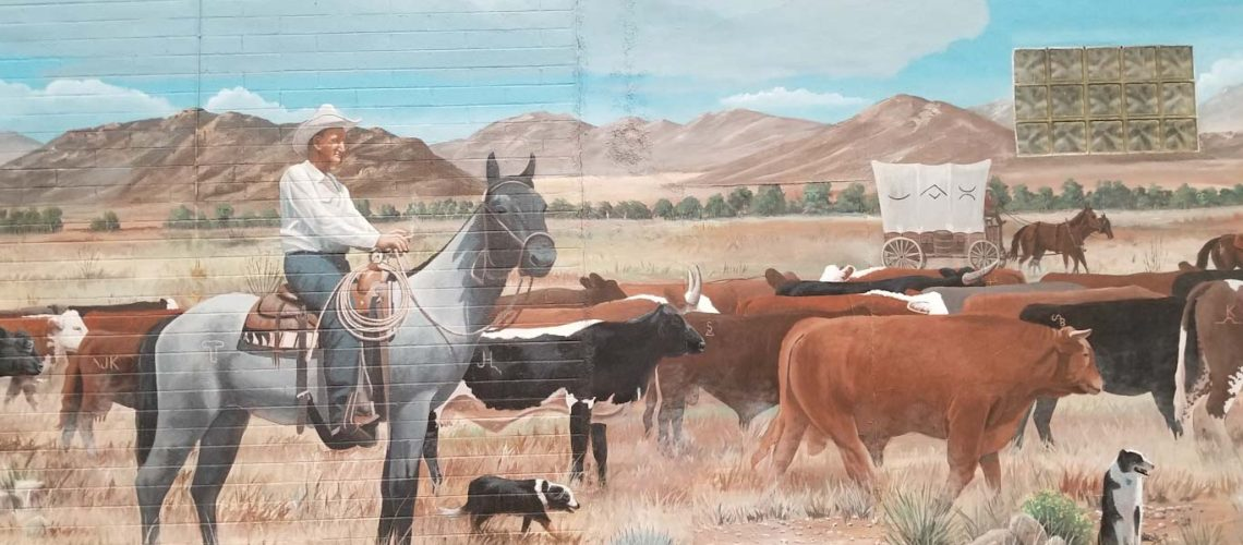 Mural of cowboy on horses