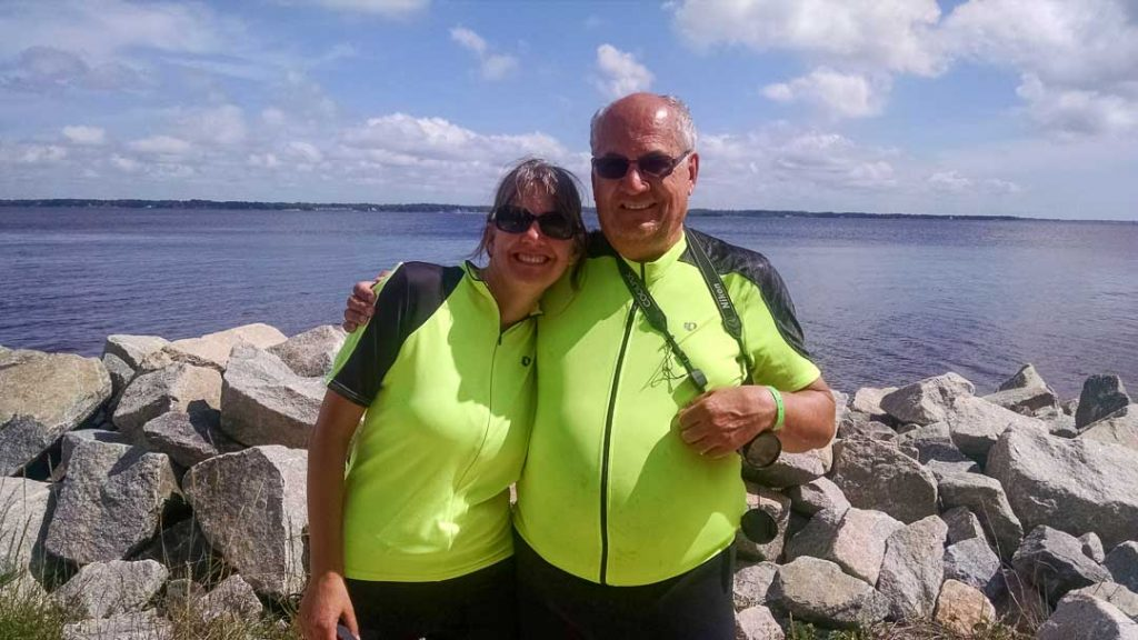 two cyclists in front of Neuse River