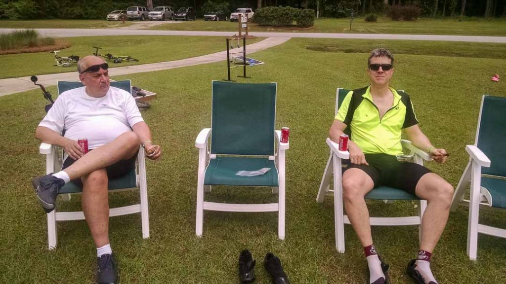 Two men sitting in lawn chairs at Cycle NC rest stop